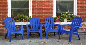 Adirondack chairs and red brick wall Dubuque Iowa Royalty Free Stock Images