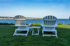 Adirondack chairs overlooking ocean in Newport. On the grounds of Chandler House in Newport Rhode Island overlooking First Beach stock photos