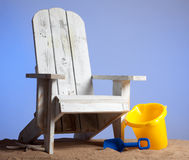 Adirondack chairs on sand with blue sky Royalty Free Stock Photos