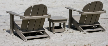 Adirondack Chairs in the sand. Royalty Free Stock Photography