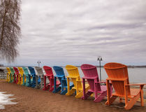 Adirondack chairs on the shore of The Saint Lawrence River. Facing The Thousand Islands in Clayton, New York stock image