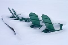 Adirondack Chairs in the Snow Royalty Free Stock Photo