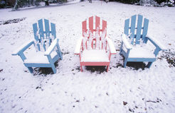 Adirondack chairs in snow, NY Royalty Free Stock Images