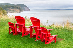 Adirondack Chairs on the top of a Cliff Royalty Free Stock Image