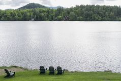 Adirondack Chairs. With a view of Mirror Lake Stock Photo