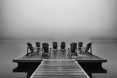 Free Adirondack Deck Chairs On Lake Dock Royalty Free Stock Photo - 123545345