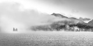Adirondack mountains and lake in fog royalty free stock photo