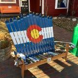 Adirondack stol som göras av använt, skidar royaltyfri bild