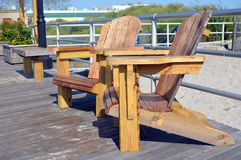 Adirondack style chairs on the boardwalk. Wooden adirondack style chairs on the boardwalk at Atlantic City, New Jersey royalty free stock images