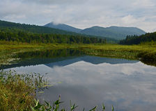Adirondack wilderness waterway and mountains landscape Stock Photography