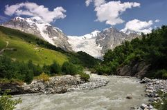 Adishi glacier with Adishi grove. Famouse glacier river crossing place in Svaneti with beautiful view at Adishi glacier Royalty Free Stock Images