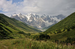 Adishi glacier with meadow. Famouse place in Caucasus - Upper Svaneti with beautiful view at Adishi glacier Royalty Free Stock Images