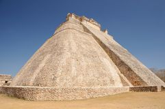 Adivino pyramid in Uxmal, Mexico. The Pyramid of the Magician (El Adivino) is the central structure in the Maya ruin complex of Uxmal Royalty Free Stock Images