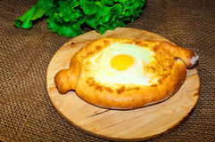 Adjara khachapuri bread with cheese and egg Royalty Free Stock Image