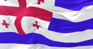 Adjaran flag waving at wind in slow with blue sky, loop. Adjara flag waving at wind in slow with blue sky, loop stock video footage