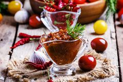 Adjika -从蕃茄的传统亚美尼亚辣调味汁,响铃pe 免版税库存照片