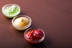 Adjika,mustard,wasabi in a glass bowl Stock Images