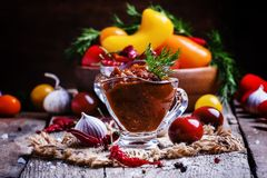 Adjika - traditional Armenian spicy sauce from tomatoes, bell pe royalty free stock photography