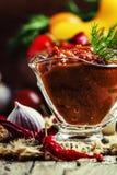 Adjika - traditional Armenian spicy sauce from tomatoes, bell pe stock photo