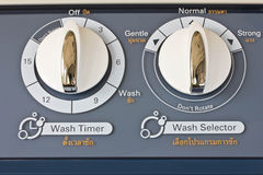 Adjust button the washing machine. Royalty Free Stock Photo