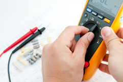 Adjust Multi meter to check Value spec. Checking Circuit by Multi-Meter. Electrical Engineer on during checking circuit board unit by Multi-Merer Stock Photos