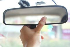 Adjust rear view mirror Stock Image