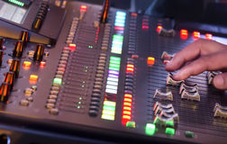 Adjust sound mixer switch in concert Stock Images