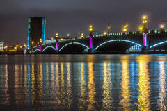 Adjustable bridges at night. Broken bridges at night, colored lights reflected in the water Stock Images