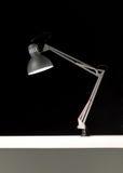 Adjustable desk lamp over black background Stock Image