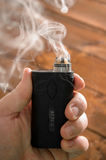 Adjustable electronic cigarette, Non carcinogenic alternative for smoking. Vape Stock Photo