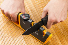 Adjustable manual knife sharpener Stock Images