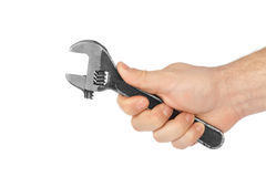 Adjustable spanner in hand Stock Image