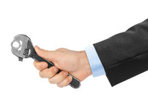 Adjustable spanner in hand Royalty Free Stock Photography