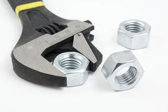 Adjustable spanner and nuts Royalty Free Stock Image