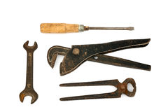Adjustable spanner with old tools Stock Photography