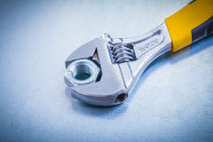 Adjustable spanner and screw nut on metallic Royalty Free Stock Photos