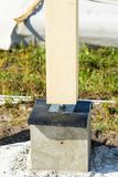 Adjustable wooden post support. Construction of a wooden house. stock photos