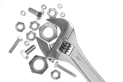 Adjustable work wrench. With nuts and screws Stock Photos