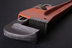 Adjustable Wrench. Big wrench, in black background. (Low key Stock Photography