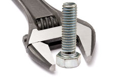 Adjustable wrench and bolt royalty free stock photos