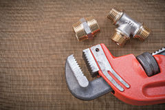 Adjustable wrench brass connector fittings on Royalty Free Stock Image