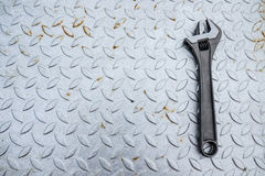 Adjustable wrench on chequered plate Royalty Free Stock Photo