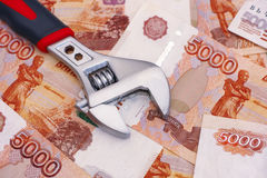 Adjustable wrench on five thousand rubles Stock Photography