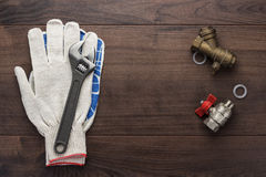 Adjustable wrench gloves and pipes Royalty Free Stock Image