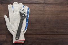 Adjustable wrench and gloves Stock Image