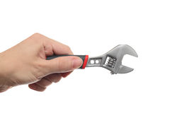 Adjustable Wrench in hand Royalty Free Stock Images