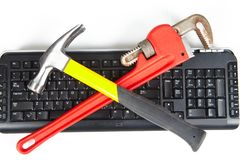 Adjustable wrench and keyboard Stock Photos