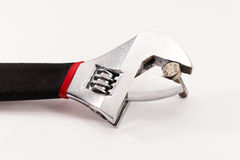 Adjustable wrench with nut isolated on white background Royalty Free Stock Images