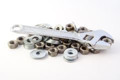 Adjustable wrench & nuts Stock Photography