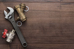 Adjustable wrench and pipes Royalty Free Stock Images
